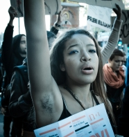 An occupier marches against police brutality in New York City.